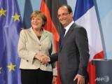 Picture: Меркел и Оланд с опит да помирят Русия и Украйна