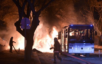 Firefighters try to extinguish flames following an explosion after an attack targeted a convoy of military service vehicles in Ankara on February 17, 2016.  At least five people were killed and 10 people were wounded in a car bombing in the Turkish capital Ankara on February 17, the city's governor said. The attack targeted a convoy of military service vehicles, Ankara governor Mehmet Kiliclar said, quoted by the CNN-Turk and NTV channels.  / AFP / STRINGERSTRINGER/AFP/Getty Images