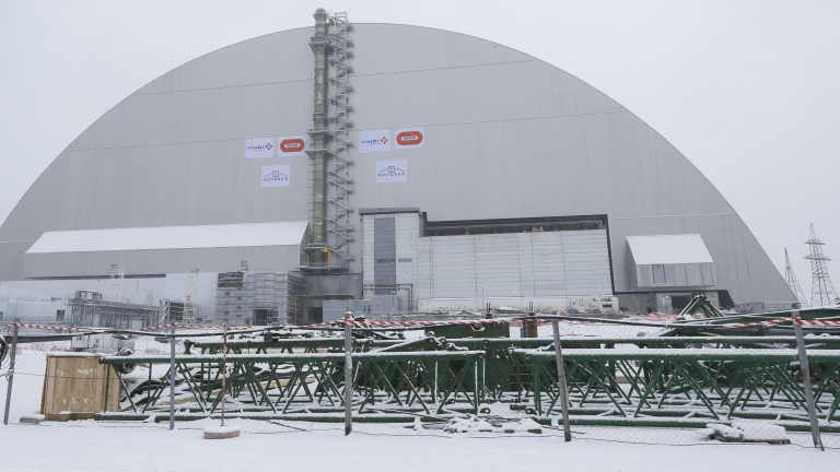 epa05651740 General view of the new protective shelter which placed over the remains of the nuclear reactor Unit 4, at Chernobyl nuclear power plant, in Chernobyl, Ukraine, 29 November 2016. The explosion of Unit 4 of the Chernobyl nuclear power plant in the early hours of 26 April 1986 is still regarded the biggest accident in the history of nuclear power generation. Under extremely hazardous conditions a steel and concrete structure was built hastily immediately after the accident. The new concrete and steel built over the still-radioactive remains of a reactor which was melted down as a result of the accident and has 105 meters tall, 150 meters length with a width of 257 meters and a 100 years life expectancy of the confinement. EPA/SERGEY DOLZHENKO