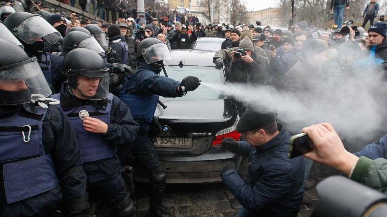 epaselect epa06368323 Protestors clash with police as they try to stop the arrest of the former Georgian president and ex-Odessa Governor Mikheil Saakashvili in downtown Kiev, Ukraine, 05 December 2017. The leader of the Movement of New Forces Party Mikheil Saakashvili has been detained in Kyiv on the roof of a residential building housing his flat amid a raid by the SBU Security Service and the Prosecutor General's Office of Ukraine. Saakashvili was given a notice of suspicion connecting with the financing of the anti-government rally and tent camp near of Ukrainian Parliament as local media reported.  EPA/STEPAN FRANKO