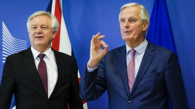 epa06613899 United Kingdom's Secretary of State for Exiting the European Union, David Davis and Michel Barnier (R), the European Chief Negotiator of the Task Force for the Preparation and Conduct of the Negotiations with the United Kingdom under Article 50 prior to a meeting in Brussels, Belgium, 19 March 2018. Reports state that David Davis, is in Brussels to meet Michel Barnier during which they hope to finalise a Brexit transition deal.  EPA/OLIVIER HOSLET
