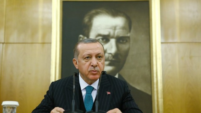 epa06632498 A handout photo made available by the Turkish Presidential Press Office on 27 March shows Turkish President Recep Tayyip Erdogan speaking to the media in front of the Ataturk's picture at Ataturk airport in Istanbul, Turkey, 26 February 2018, before travelling to Algeria. According to news report Turkish President Recep Tayyip Erdogan passed Mustafa Kemal Ataturk (founder of modern Turkey) as longest ruling Turk.  EPA/TURKISH PRESIDENTAL PRESS OFFICE / HANDOUT  HANDOUT EDITORIAL USE ONLY/NO SALES