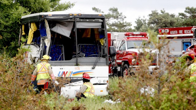 Firefighters and police officers respond to a serious collision involving a bus west of Prescott on Highway 401 on Monday, June 4, 2018 near Prescott, Ont. (MARSHALL HEALEY/Special to The Recorder and Times)