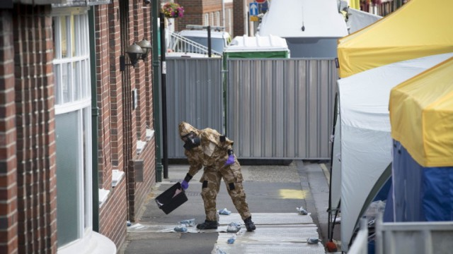 epa06868804 A Forensics officer, wearing protective equipment, at John Baker House, a supported housing scheme for the homeless in Salisbury, Wiltshire, Britain, 06 July 2018. Police state they are investigating a major incident in the Amesbury area of Wiltshire after a woman, aged 44, and a man, aged 45, who are both local to the area and are British nationals, were hospitalised on 30 June 2018, following their potential exposure to an unknown substance. A number of scenes, believed to be the areas the individuals frequented in the period before they fell ill, remain cordoned off in and around the Amesbury and Salisbury area as a precautionary measure. These include, Queen Elizabeth Gardens in Salisbury. A property at John Baker House, Rolleston Street, Salisbury. A property on Muggleton Road, Amesbury. Boots the Chemist, Stonehenge Walk, Amesbury. Amesbury Baptist Centre on Butterfield Drive, Amesbury. The Defence Science and Technology Laboratory at Porton Down confirmed to police that the man and woman had been exposed to the nerve agent  Novichok.  EPA/RICK FINDLER