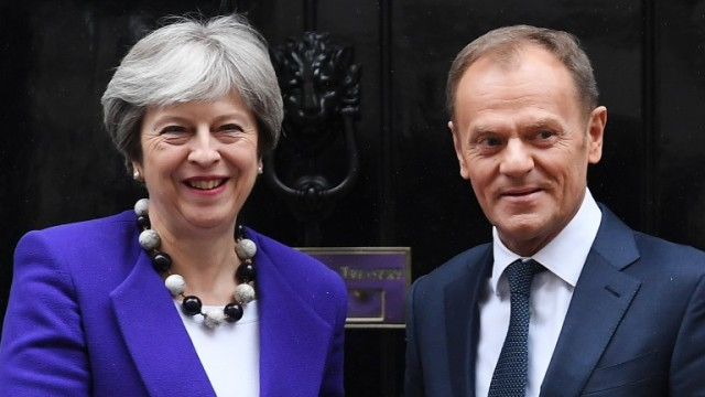 epa06572713 British Prime Minister Theresa May (L) welcomes President of the European Council Donald Tusk (R) to 10 Downing Street in London, Britain, 01 March 2018. Theresa May plans to make a major speech on British relations with the EU after Brexit on 02 March 2018.  EPA/ANDY RAIN