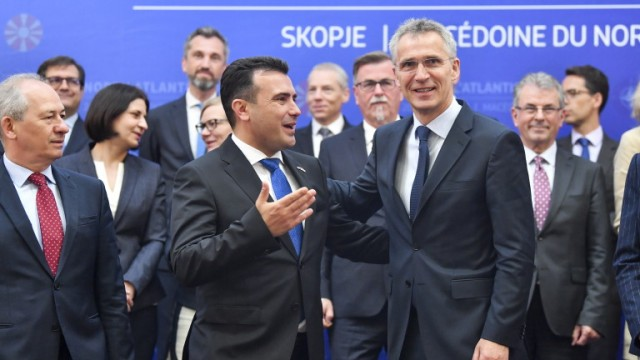 epa07622046 NATO Secretary General Jens Stoltenberg (C-R) and North Macedonia Prime Minister Zoran Zaev (C-L) react during a family photo after a session of the North Atlantic Council in Skopje, North Macedonia, 03 June 2019. Stoltenberg is on a two-day official visit to North Macedonia, which is expected to become the next country to join the North Atlantic Treaty Organization (NATO).  EPA/GEORGI LICOVSKI