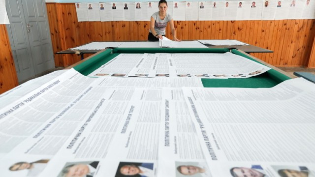 epa07729246 A member of an election committee prepares a polling station, near Kiev, Ukraine, 20 July 2019. Parliamentary elections will be held on 21 July 2019 after President Volodymyr Zelensky dissolved parliament during his inauguration on 21 May 2019.  EPA/SERGEY DOLZHENKO