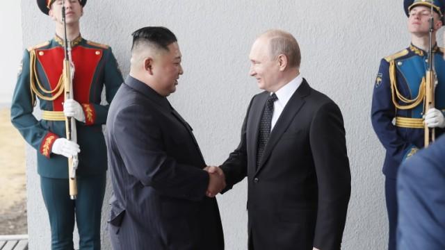 epa07526644 Russian President Vladimir Putin (R) and  North Korean leader Kim Jong Un shakes hands meeting  prior their talks at  Far East Federal University on Russky Island in Vladivostok , Russia, 25 April 2019.  EPA/SERGEI ILNITSKY / POOL